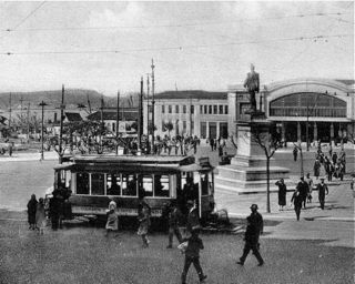 Tram in               front of the Cais do Sodré station